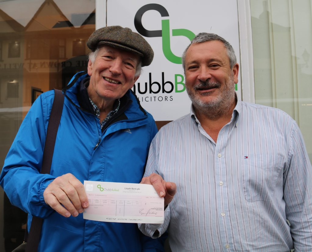 £350 cheque presented to Wells Soup